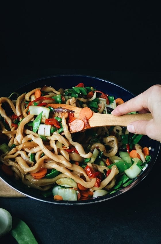 A pan full of Yaki Udon - fried homemade Udon noodles with colourful vegetables.