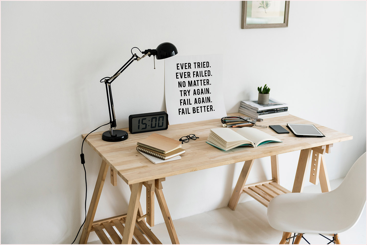 Workspace - Wooden desk with black lamp, glasses, books, tablet, motivational poster. | Helping you become a successful online solopreneur. | PearTreePond - The Solopreneur Safety Net