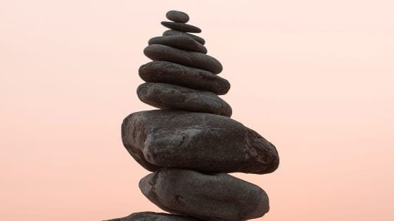 Stack of stones. Pink sunset.