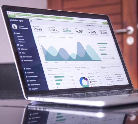 Laptop on desk showing various graphs and analysis.   Keyword Research - a powerful SEO strategy for bloggers   PearTreePond - The Solopreneur Safety Net