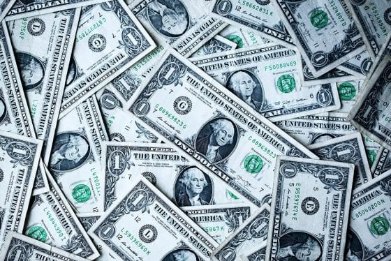 Dollar bills - Monetization strategies featured image | PearTreePond - The Solopreneur Safety Net