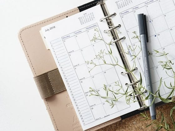 How to increase productivity; featured image of a calendar and pen