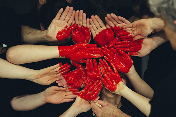 red paint heart on hands; building rapport